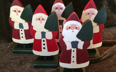 group of wooden standing santas