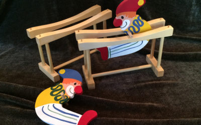 pair of kinetic clown wooden toys