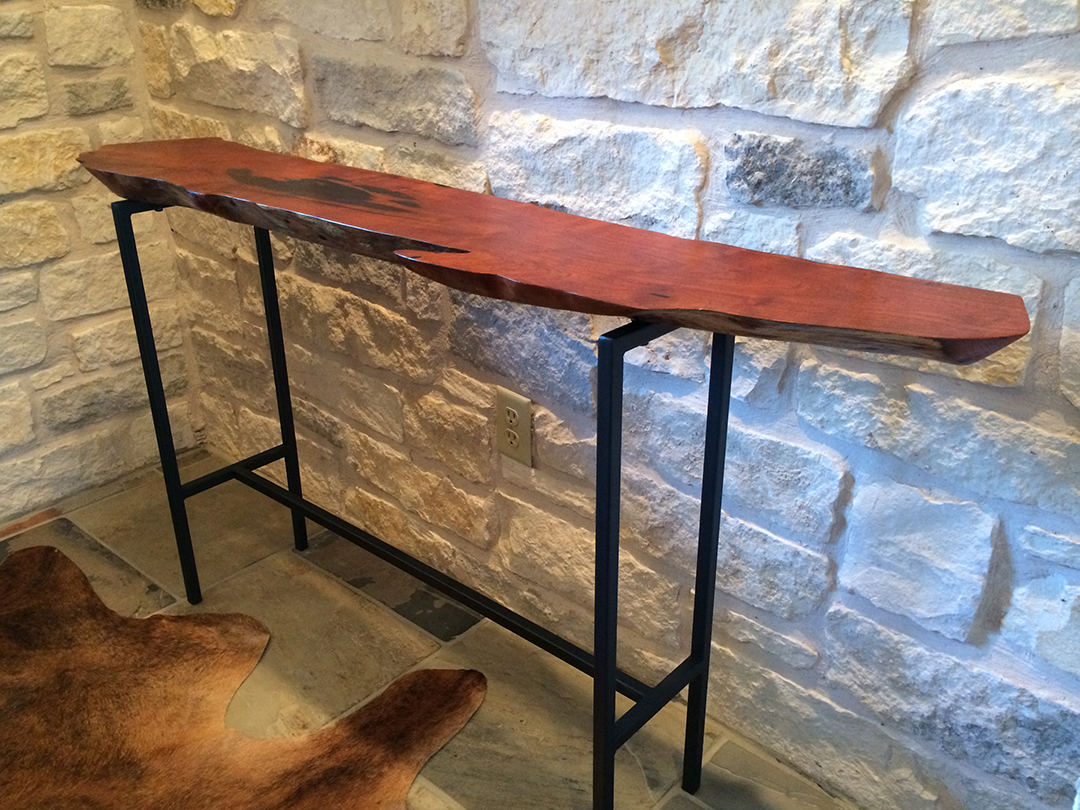 mesquite console table with black epoxy on angle