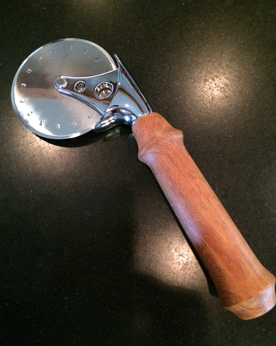 pizza wheel and cutter with wood handle