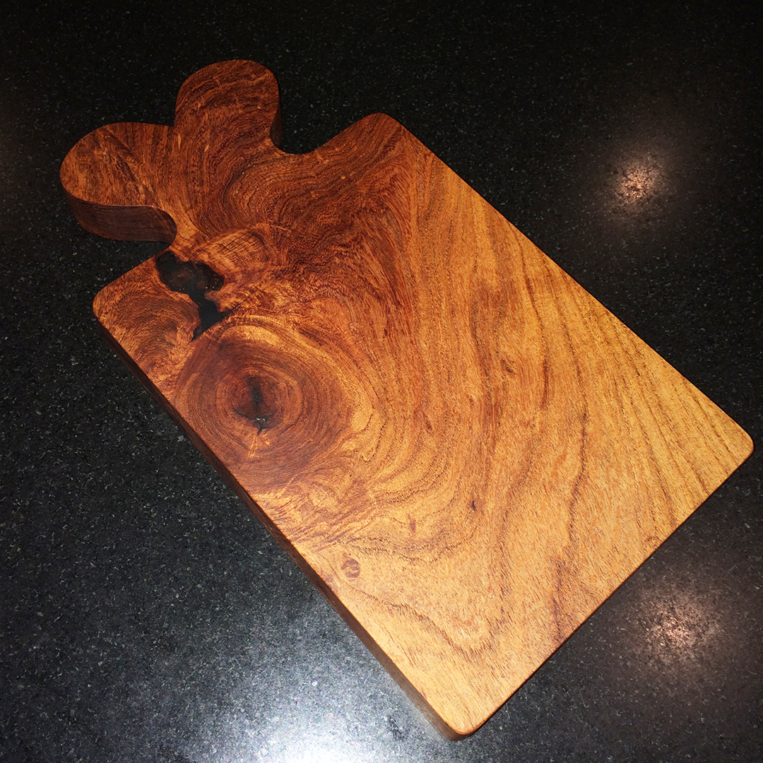 wooden cheese and bread board of mesquite