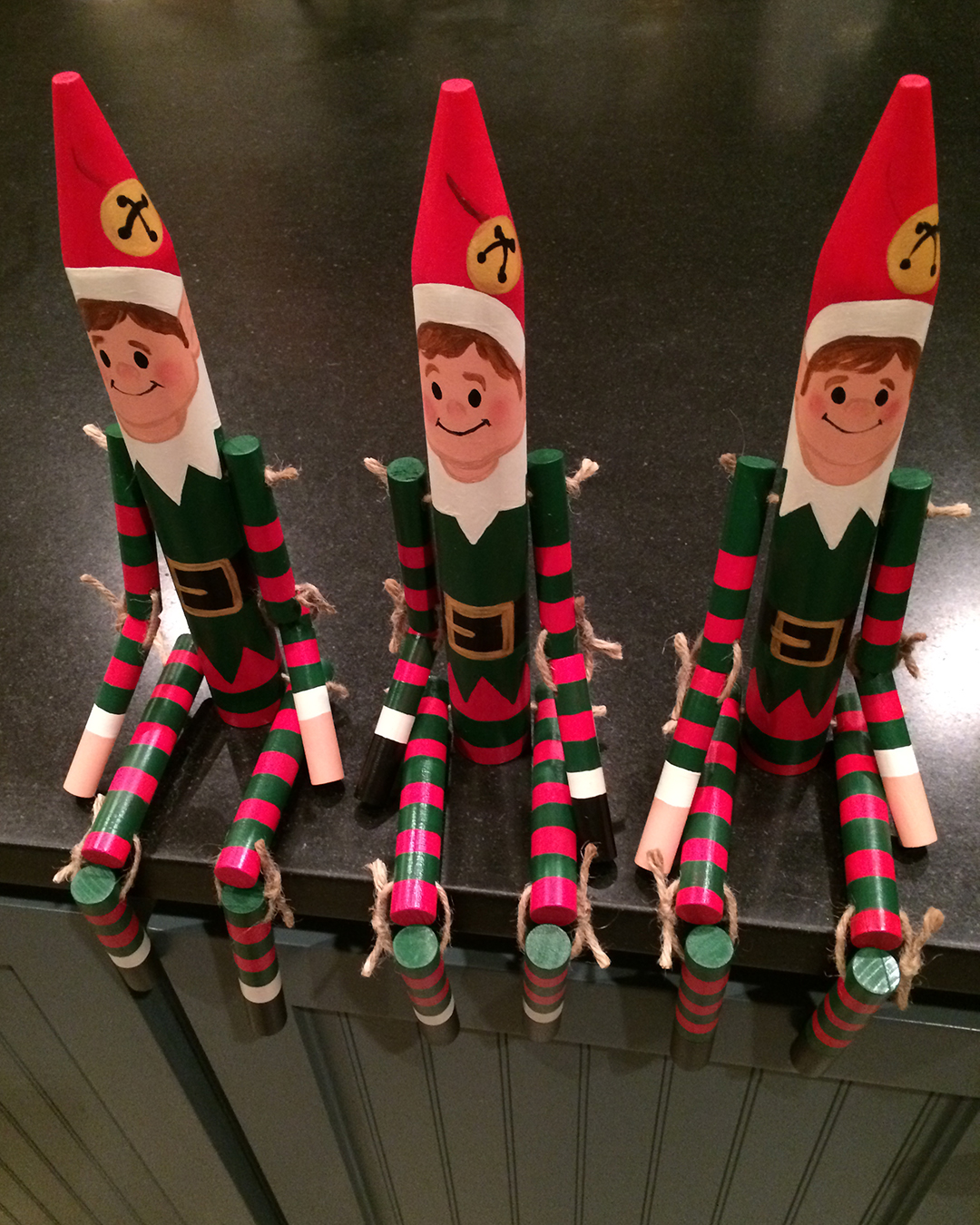 wooden roped elves sitting