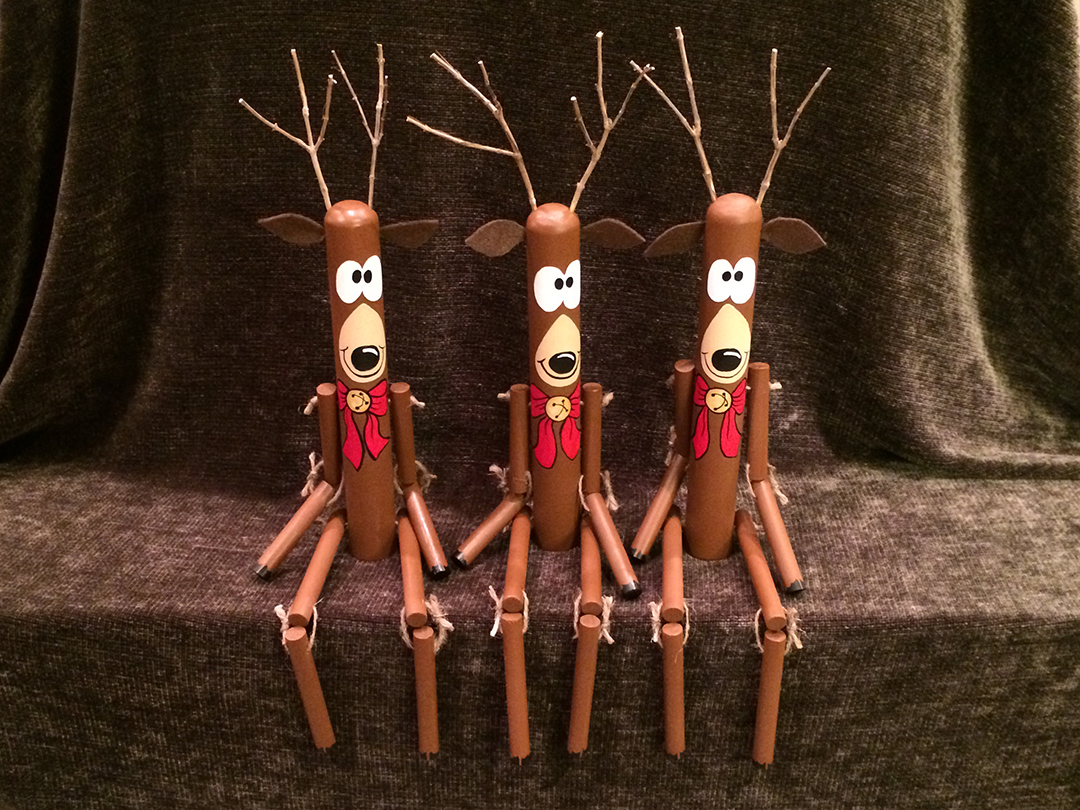hand painted roped reindeer on a ledge