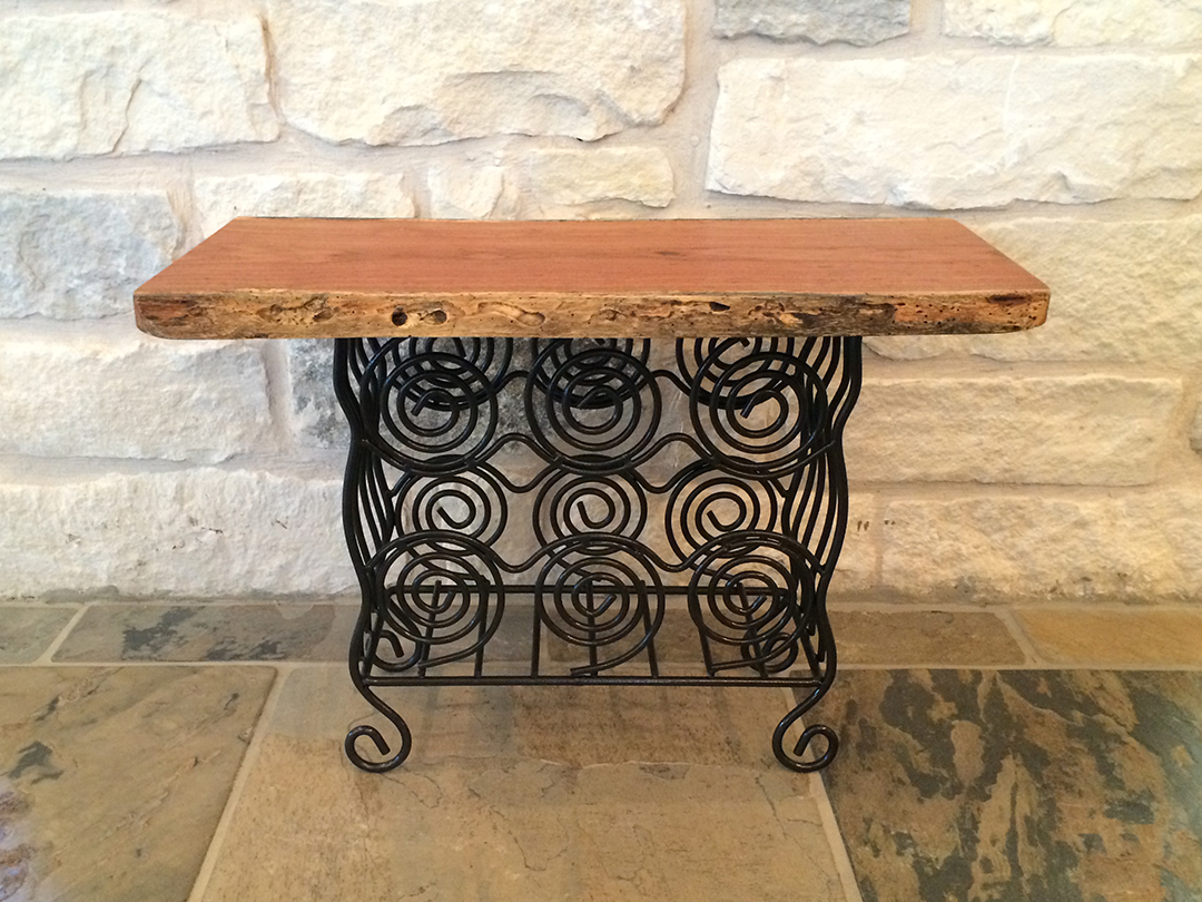 Mesquite top end table with repurposed swirly metal base