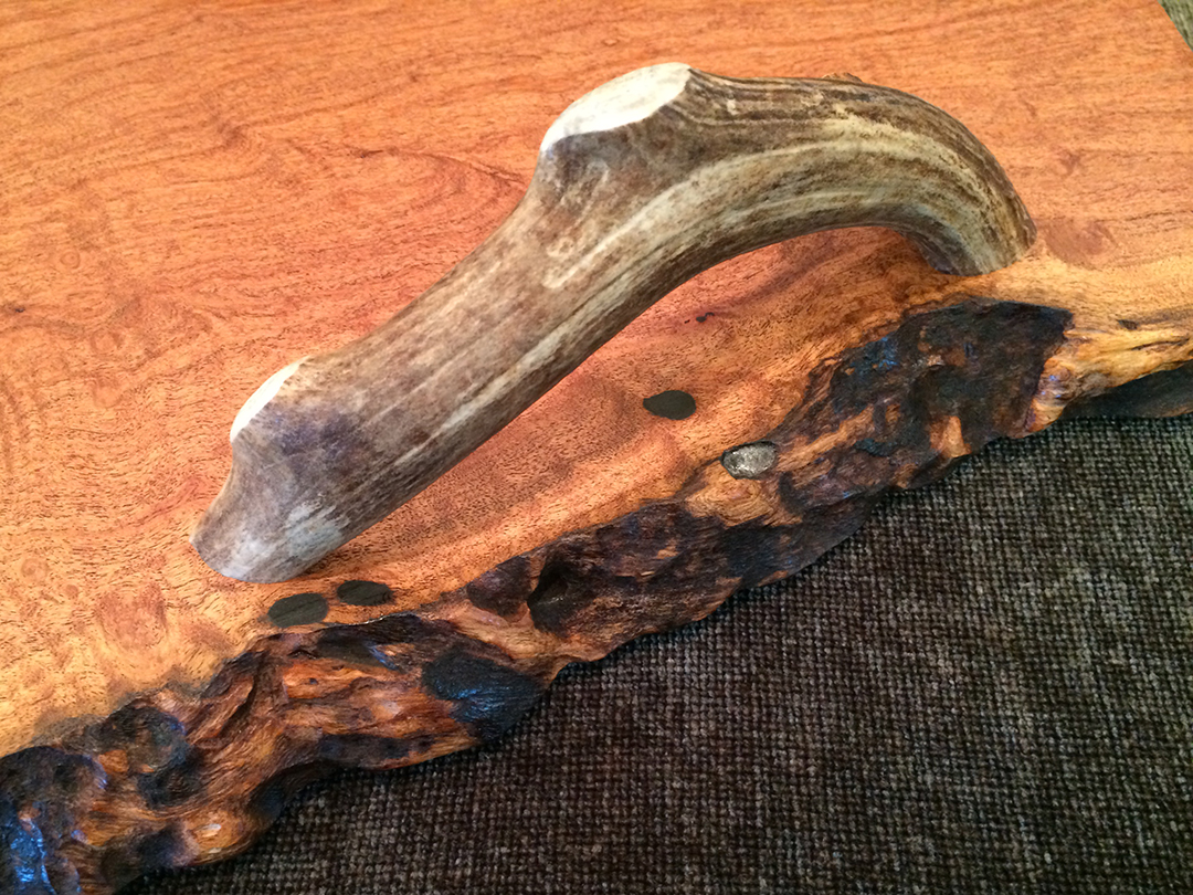 antler handle detail on Mesquite tray with live edge