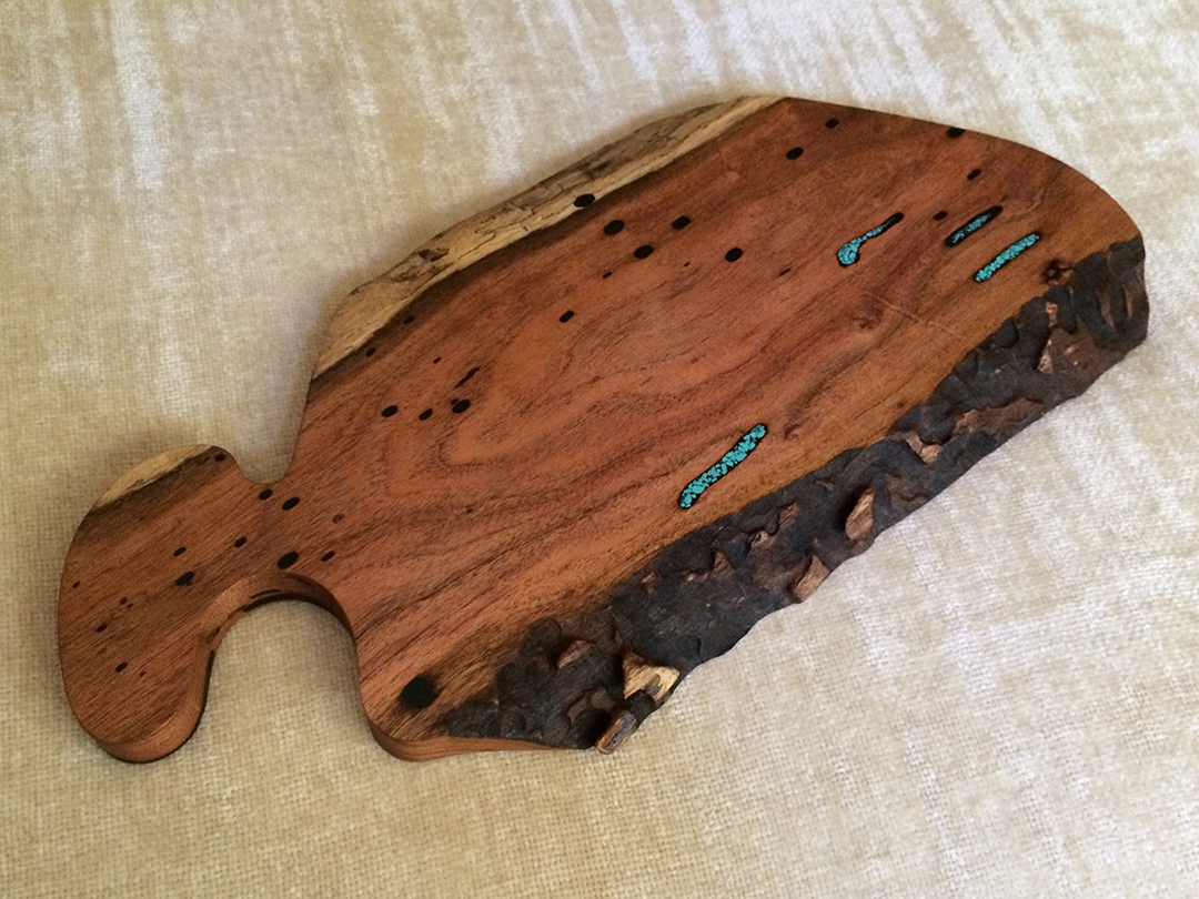 bread and cheese board made from mesquite wood with turquoise resin fill and a natural live edge