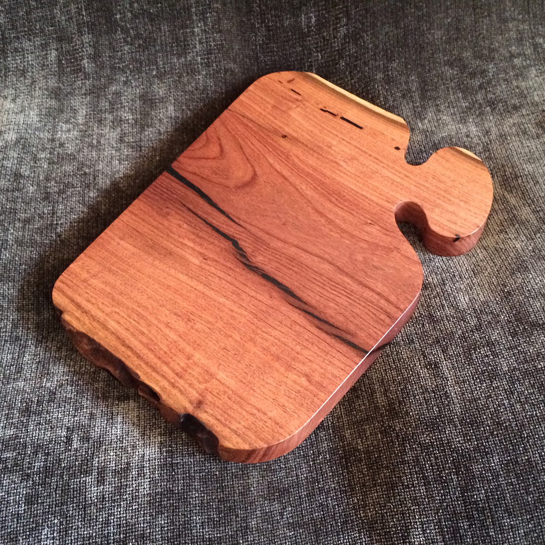 cutting board made from mesquite wood with black resin fill and live edge