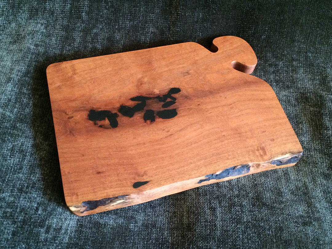 mesquite wood cutting board with black resin fill and live edge